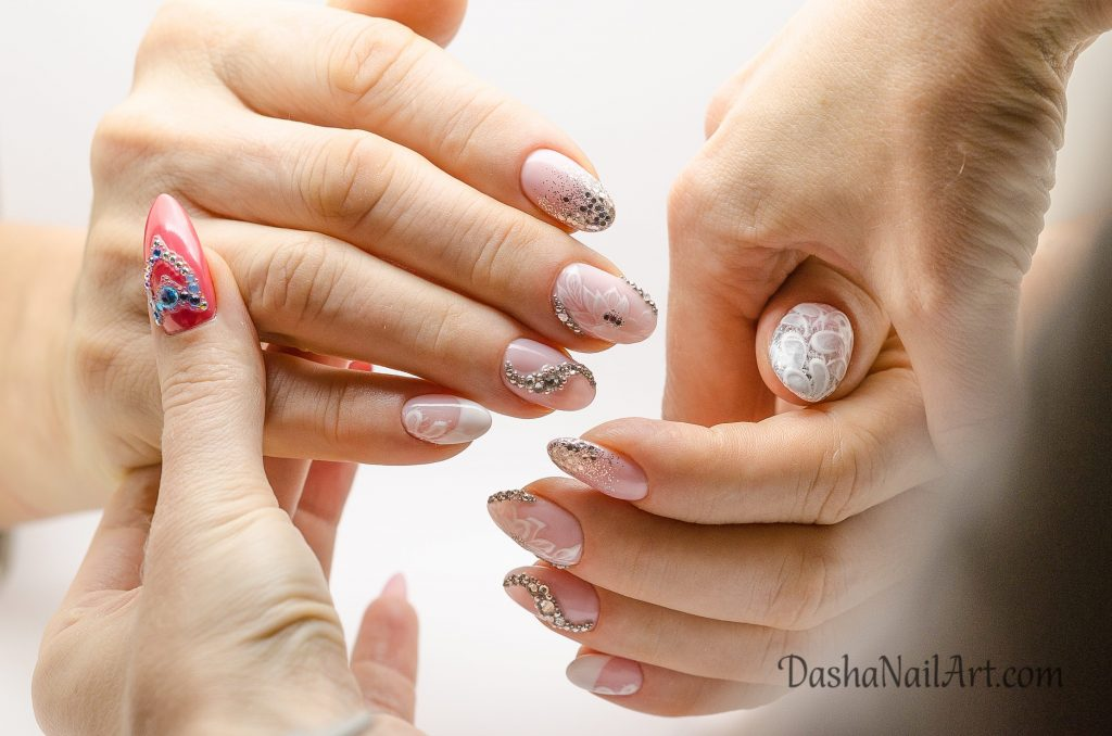 Elegant nude wedding nails with diamonds and glitters