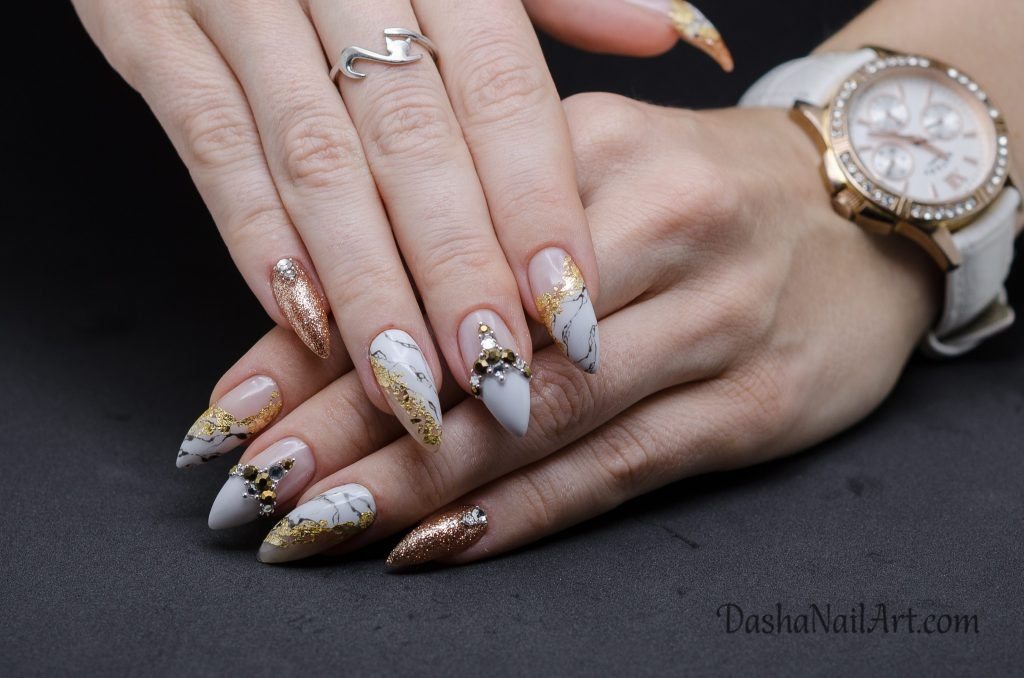 Luxury marble nails with gold foil and diamonds