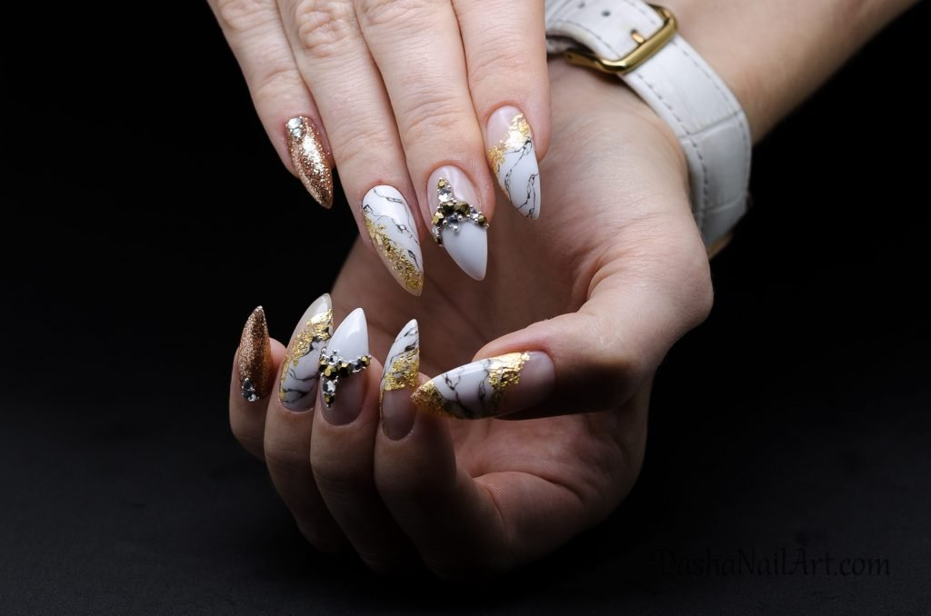 Classic nails with marble, gold foil and diamonds