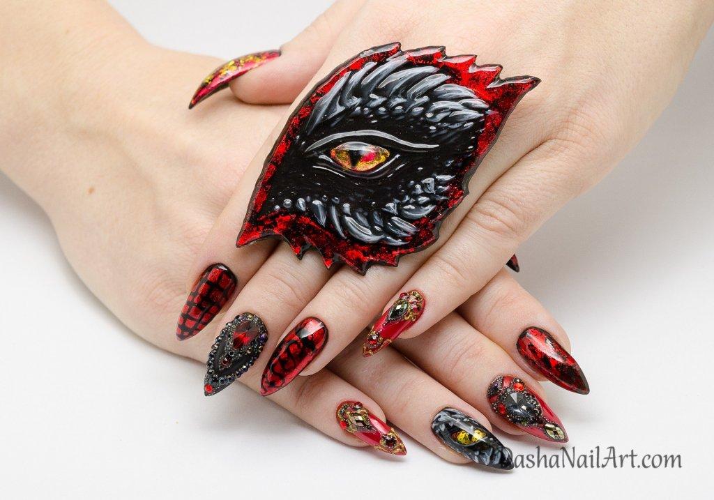 Dragon nail design with the dragon eye ring