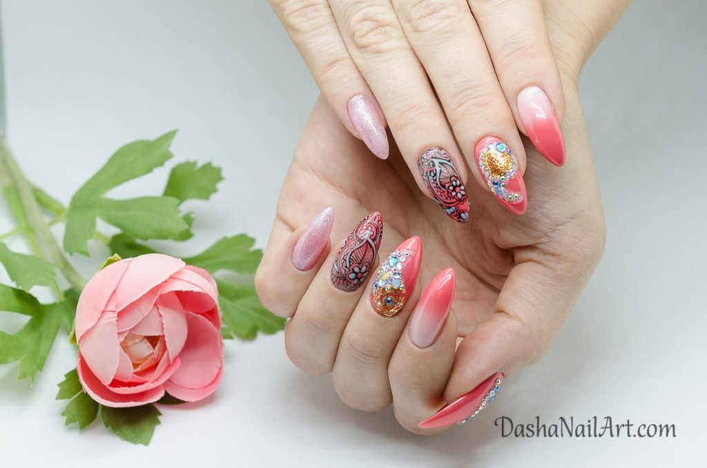 Summer almond shaped coral nails with hand drawn pattern, blue diamonds and ombre