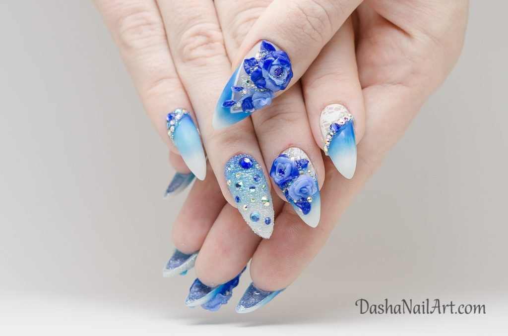 Summer blue ombre nails with 3D flowers and diamonds