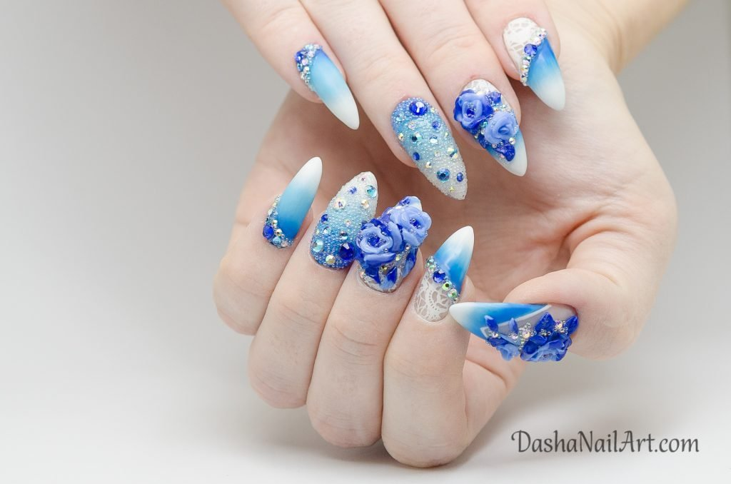 Blue roses nail design with diamonds and stones