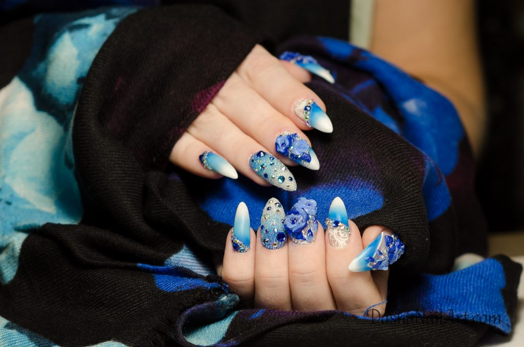 Spring blue nails with 3D flowers and diamonds