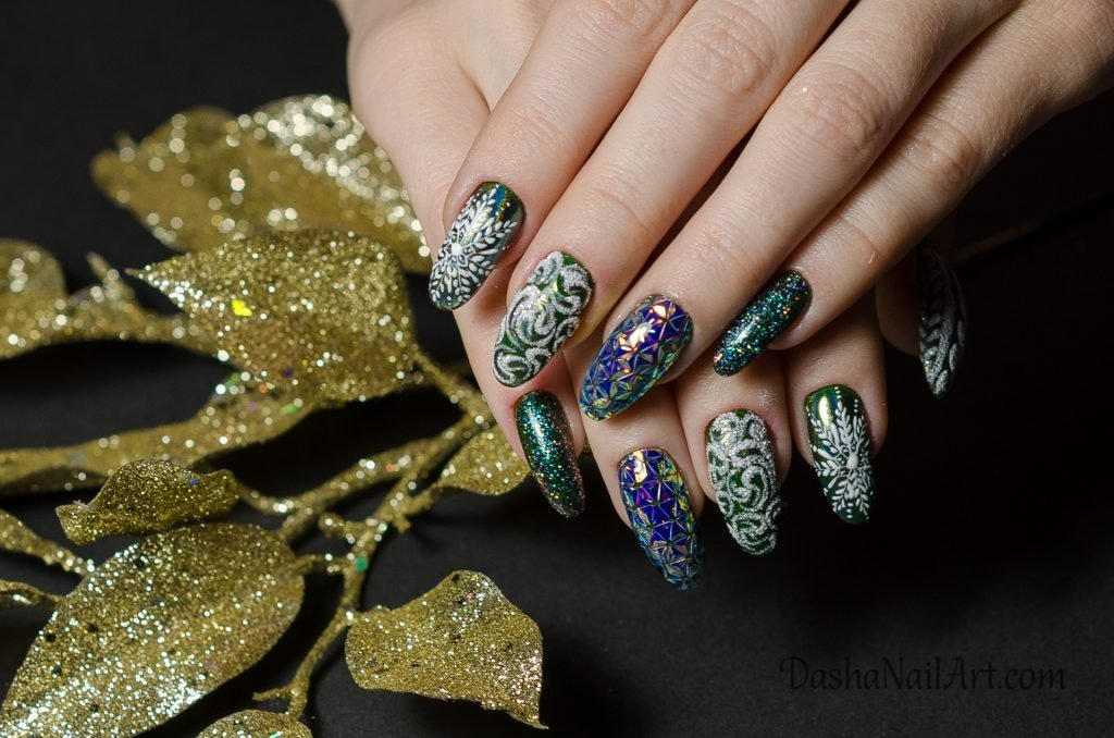 Green Christmas nails with snowflakes and winter style design