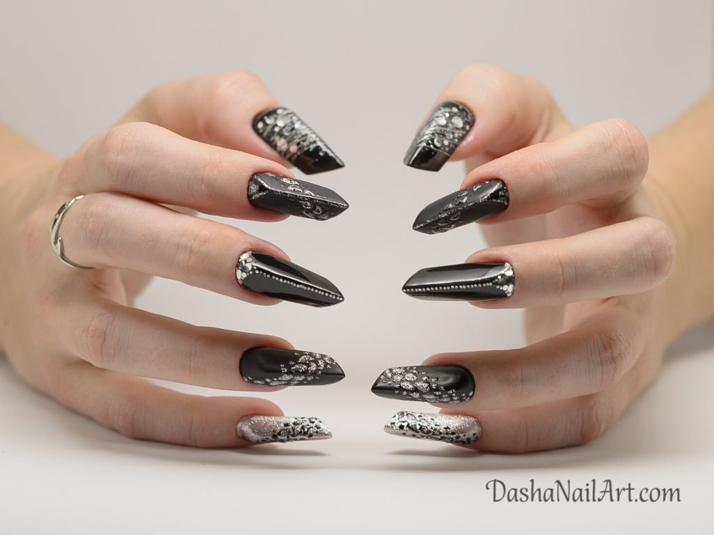 Top Edge nails with leopard print in black and silver colors