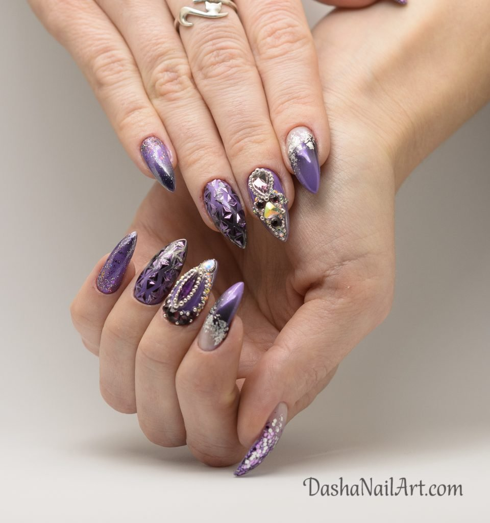 Long almond purple nails with stones and chrome