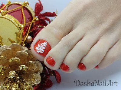 Red Christmas-tree pedicure toes
