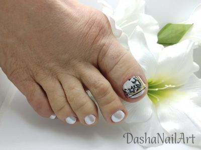 Pearl white chrome toes pedicure with flowers, gold & black stripes