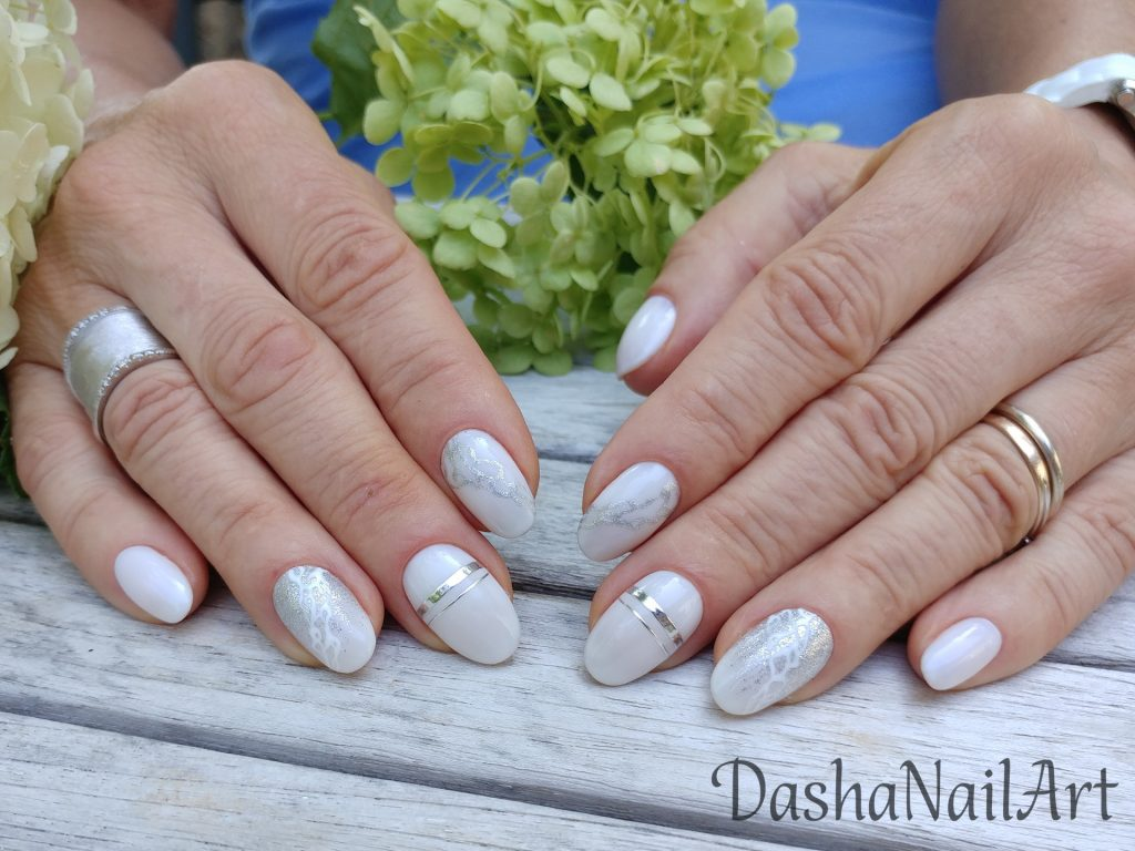 Milky white short nails with silver lines