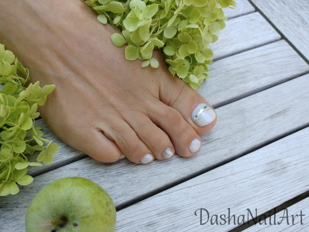 Milky white nude toes pedicure with silver stripes