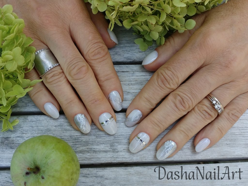 Milky white nude nails with silver rings