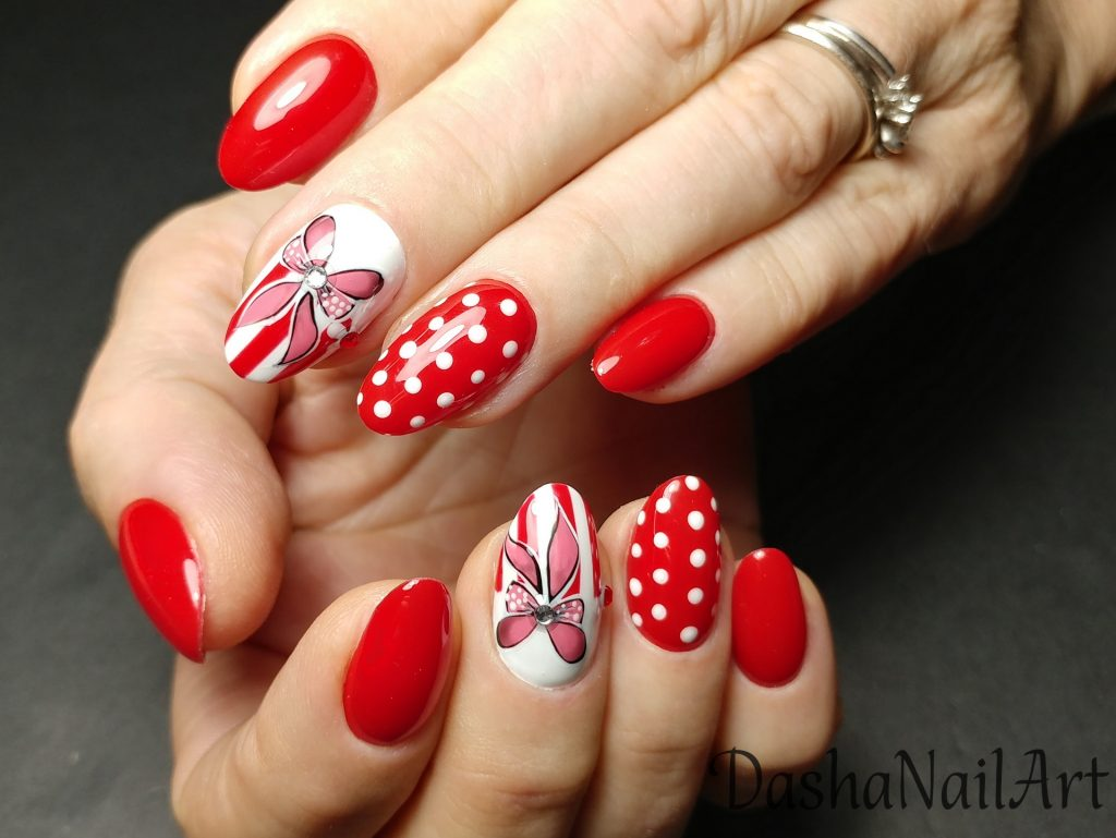 Lovely red nails with hand drawn bows