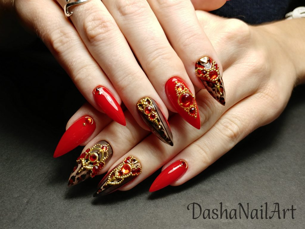 Royal stiletto red leopard print nails with red stones and metal gold decoration