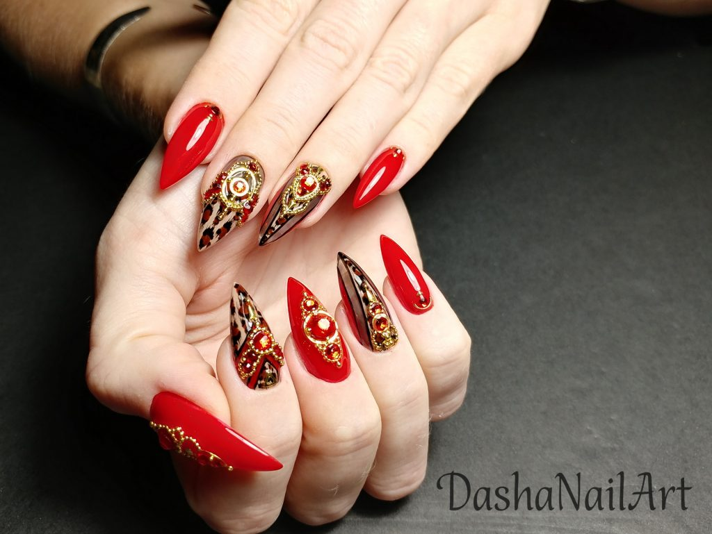 Million dollar stiletto red leopard print nails with red stones and metal gold decoration