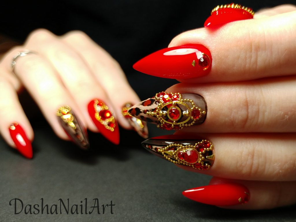 VIP stiletto red leopard print nails with red stones and metal gold decoration