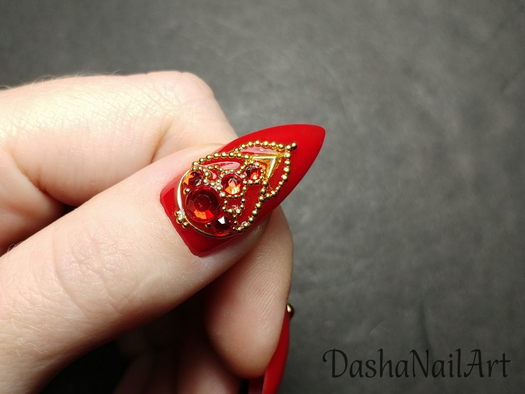Spectacular Red nail with red stones and metal gold decoration