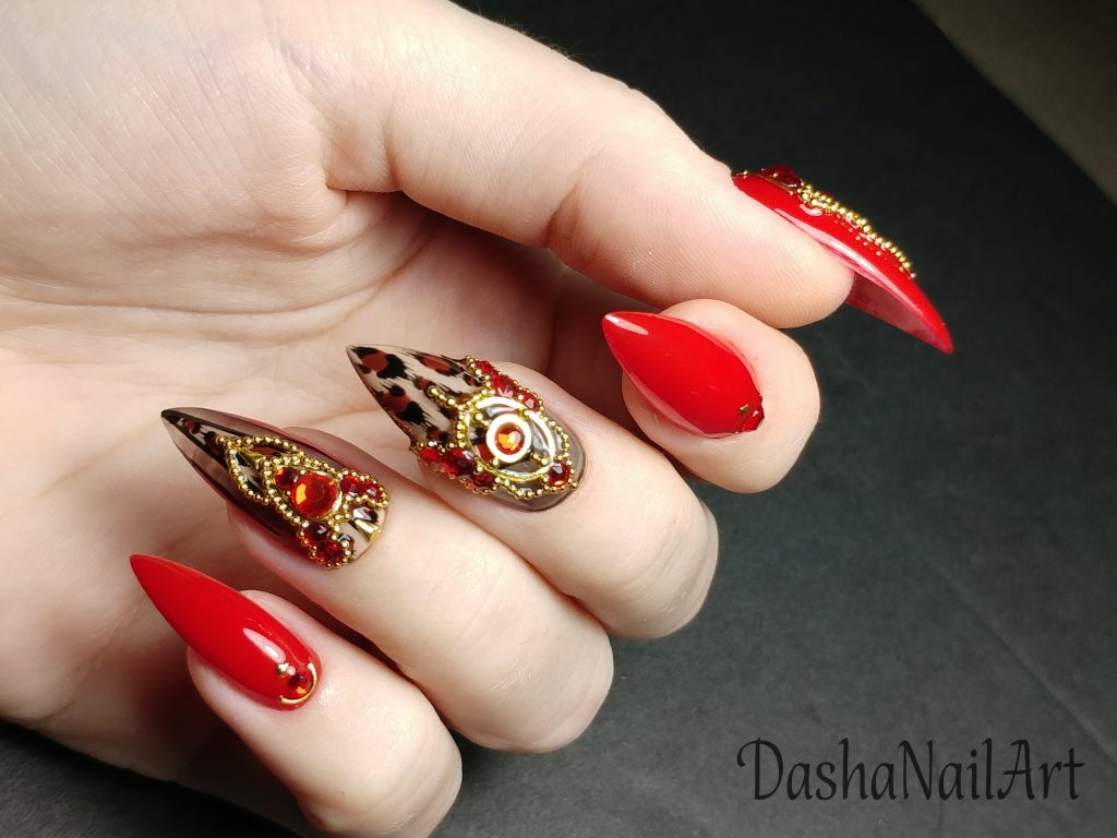 Expensive red nails with leopard print with gold and diamond incrustation