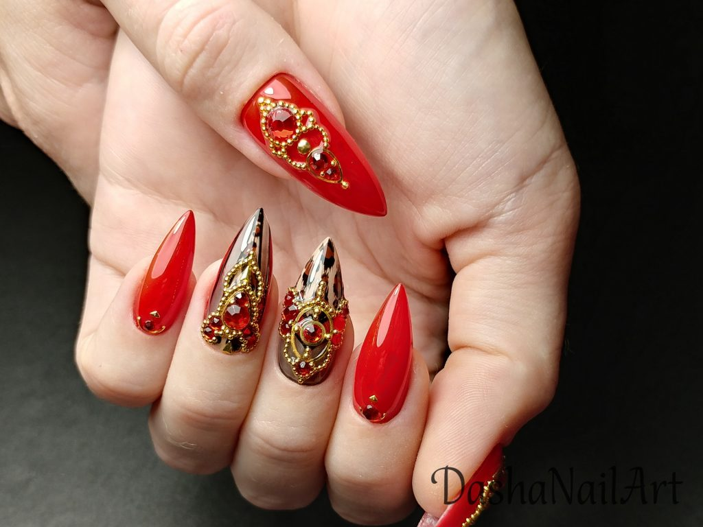 Gorgeous red nails with leopard print with gold and diamond incrustation