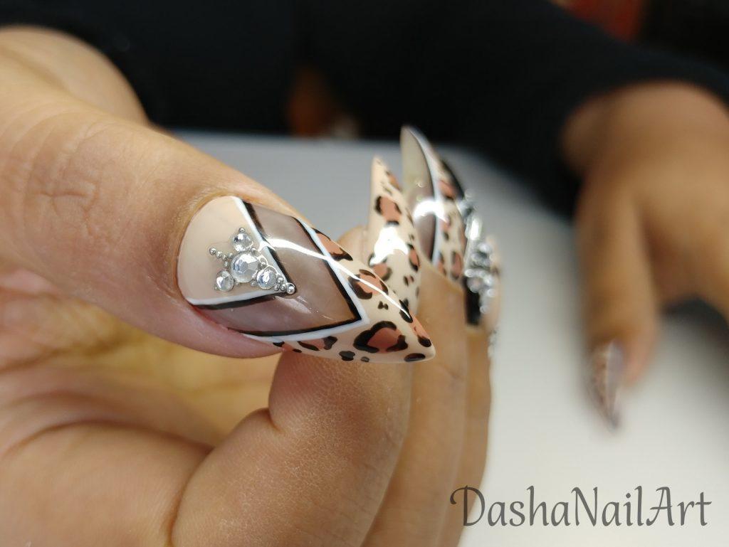 Stiletto Nude animal print nails with diamonds