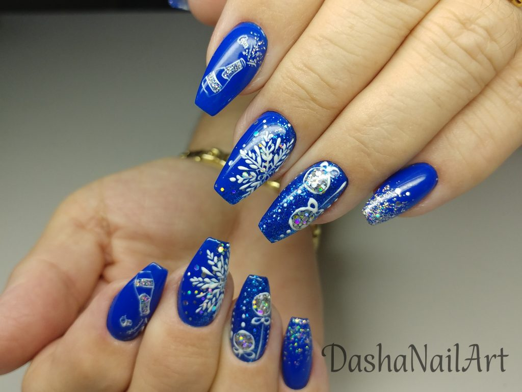 Royal New Year blue nails with glitters, tree decoration, snowflakes and champagne