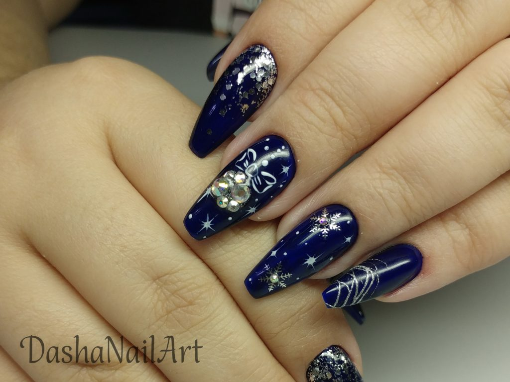 New Year royal blue nails with diamond Christmas-tree toys and silver snowflakes