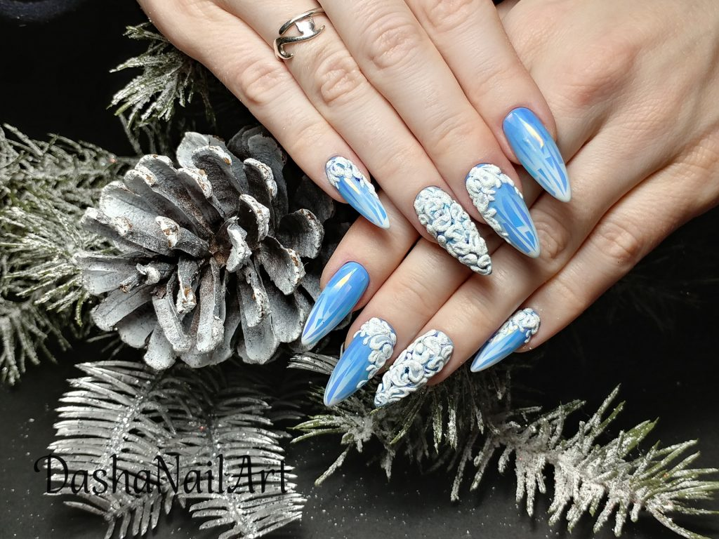 Icy blue ombre nails with broken glass design and 3D patterns