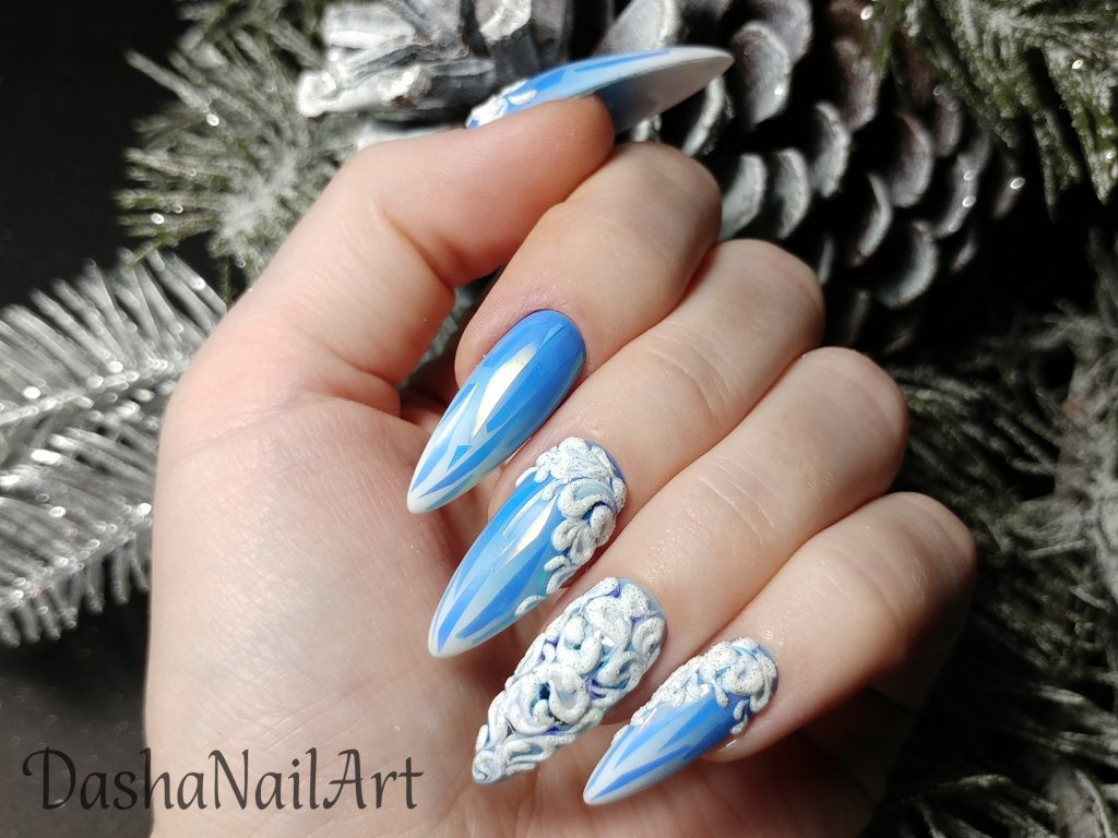 Winter blue ombre nails with broken glass design and 3D patterns
