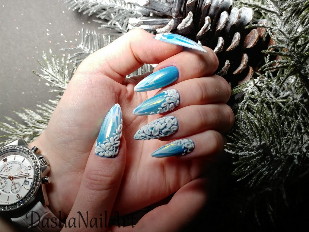 Winter nails with broken glass design and 3D patterns