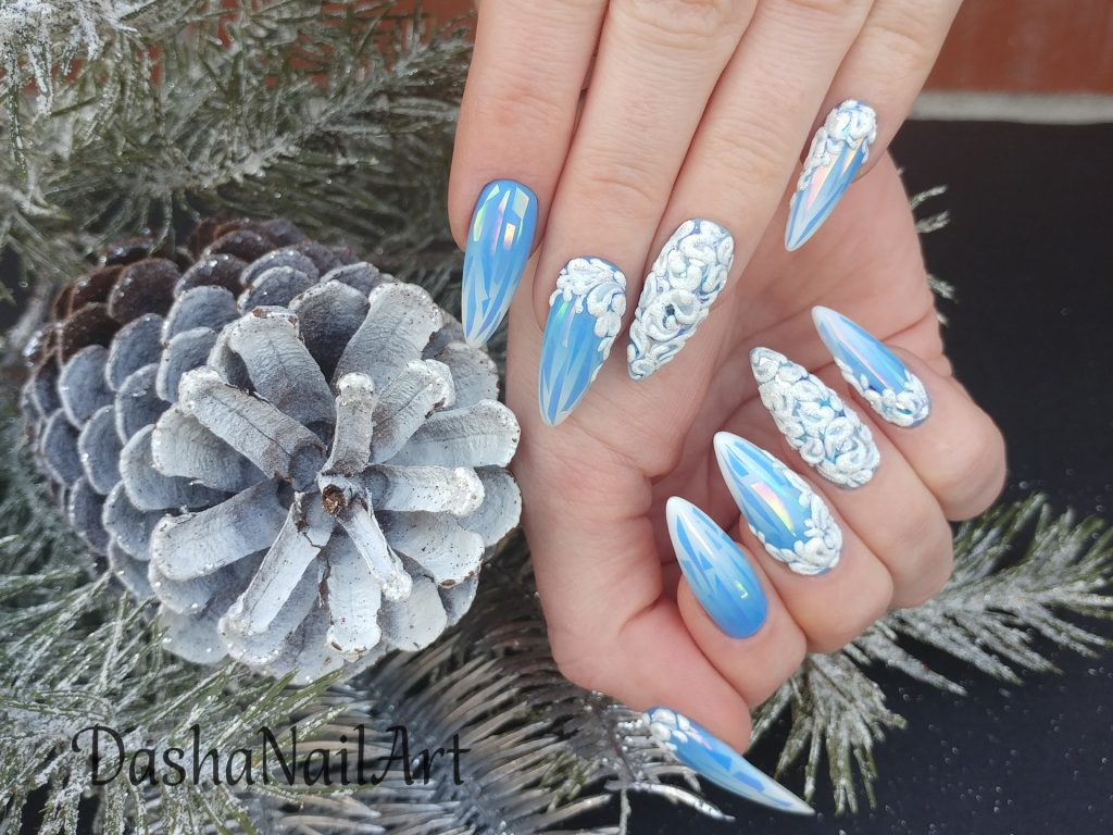 Winter ombre nails in blue with broken glass design and 3D patterns