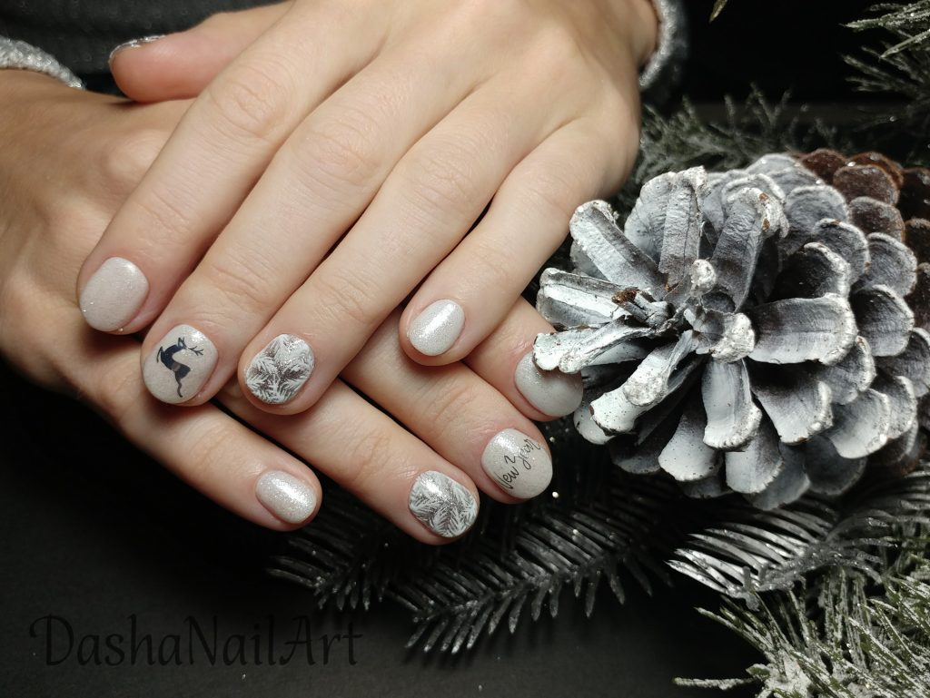 New Year nails with prancing deer and hand drawn frost patterns