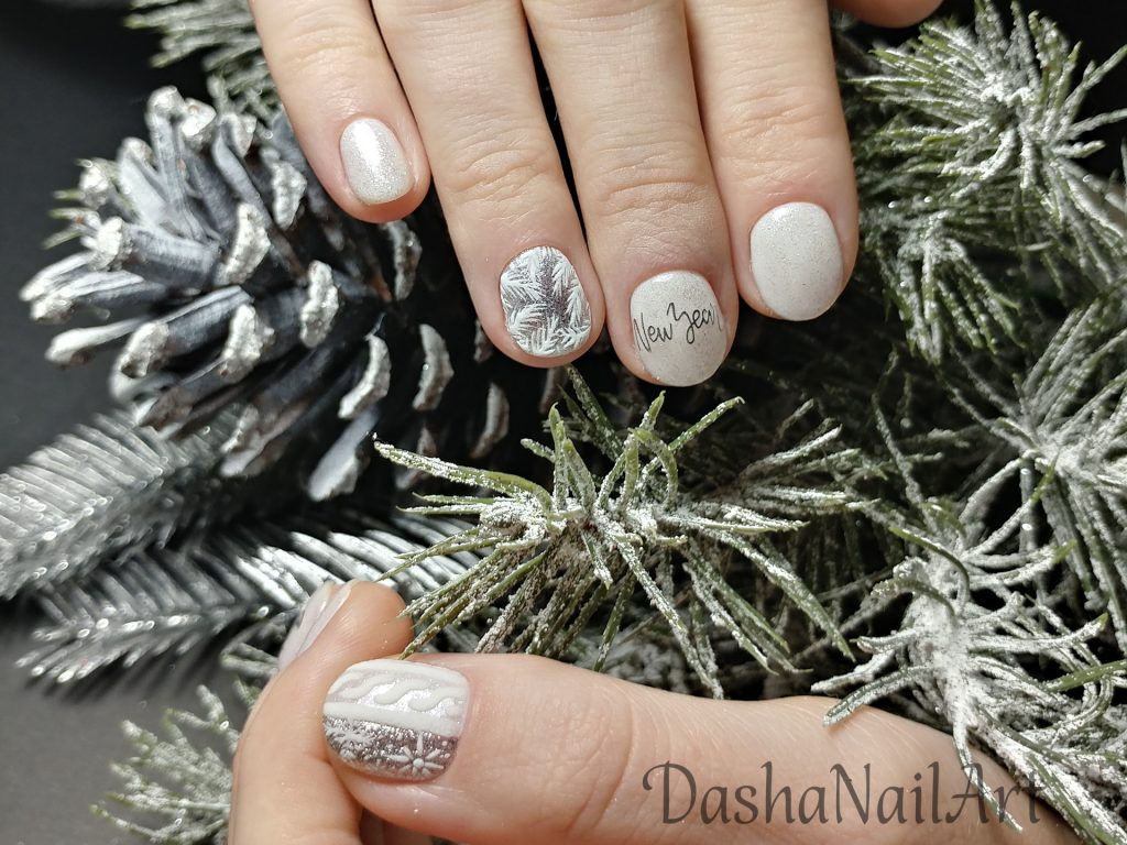 Winter nails with prancing deer and hand drawn frost patterns, silver stickers