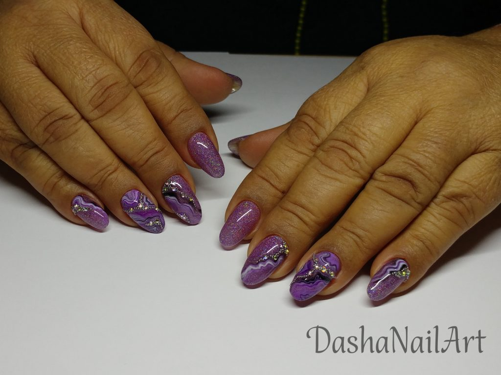Purple glitter nails with natural stone effect and diamonds