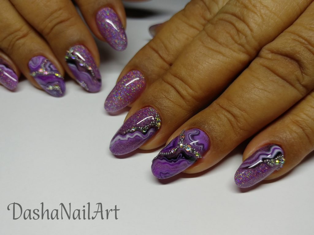 Elegant Purple glitter nails with natural stone (marble) effect and diamonds