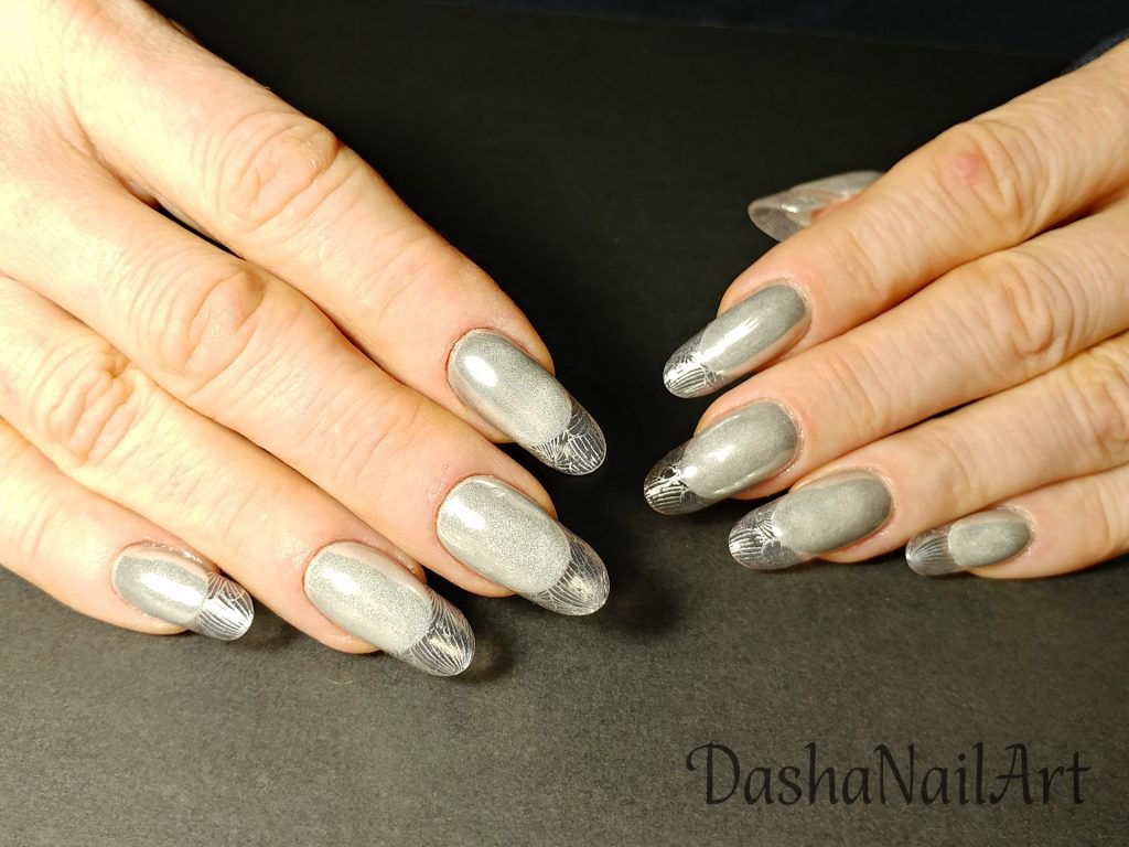 Modern almond transparent french nails with silver chrome and stamping