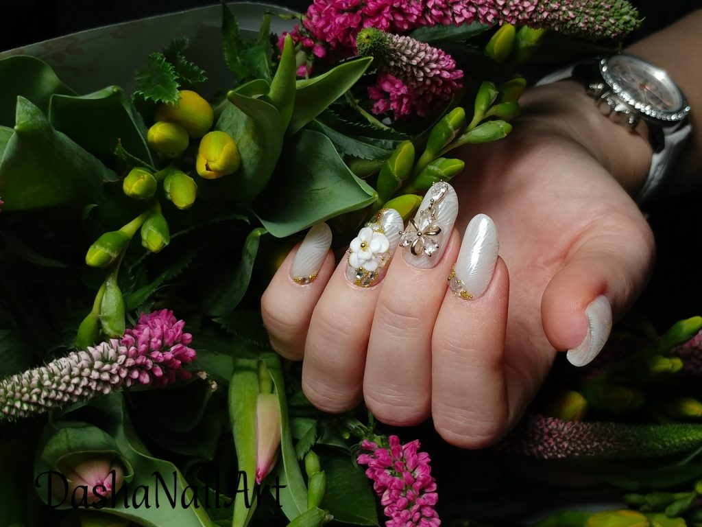 Short arch almond nails with chrome stamping and 3D flowers, jewellery and diamonds