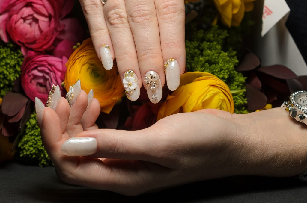Amazing white almond nails with chrome stamping and 3D flowers, jewellery and diamonds