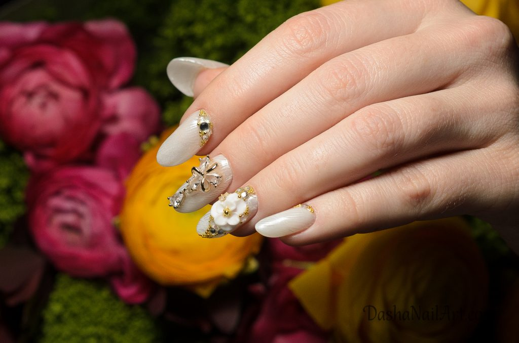 VIP arch almond nails with chrome stamping and 3D flowers, jewellery and diamonds