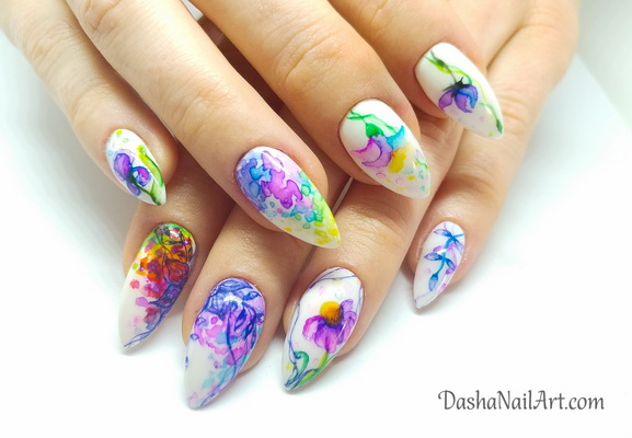 Watercolor nails in rainbow colors with hand drawn flowers