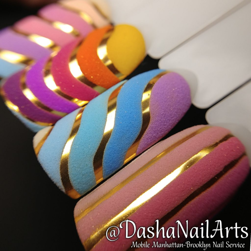 Chrome nails with rainbow patterns