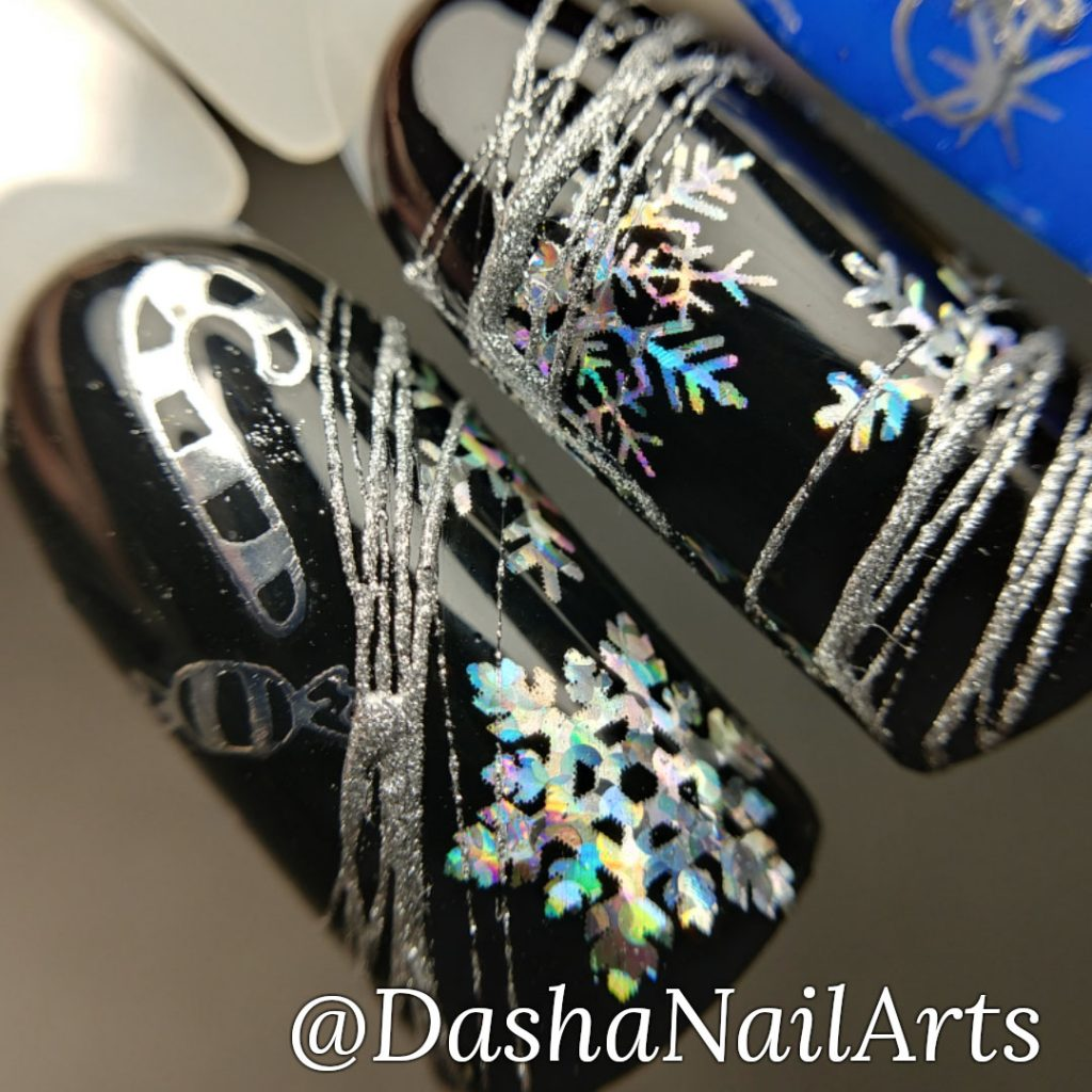 Christmas nails in black, blue and silver colors with snowflakes