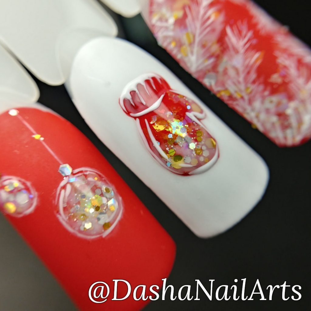 Red and white Christmas nails with hand drawn Christmas-tree decorations and mitten