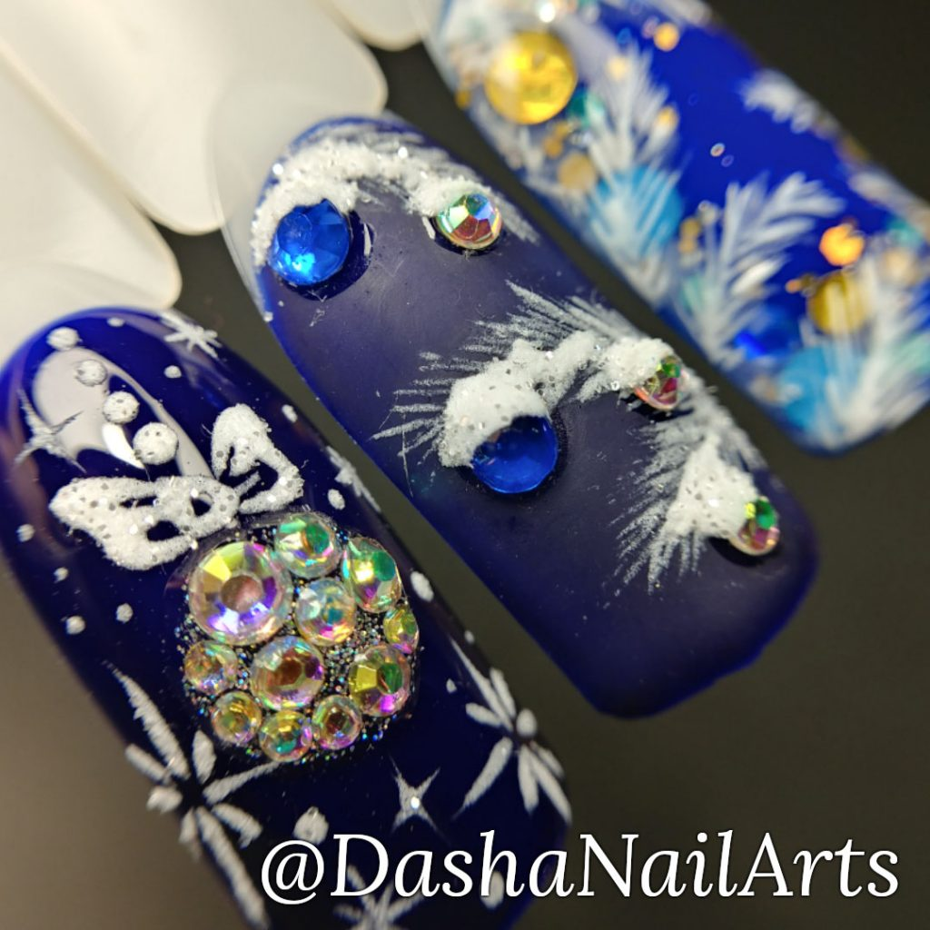 Christmas nails in blue color with diamonds and Christmas tree decorations