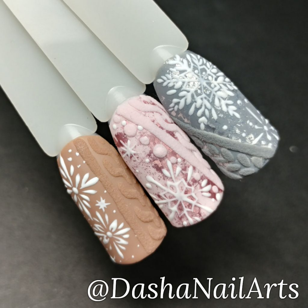 Pink and grey Christmas nails with 3D sweater nail design and snowflakes