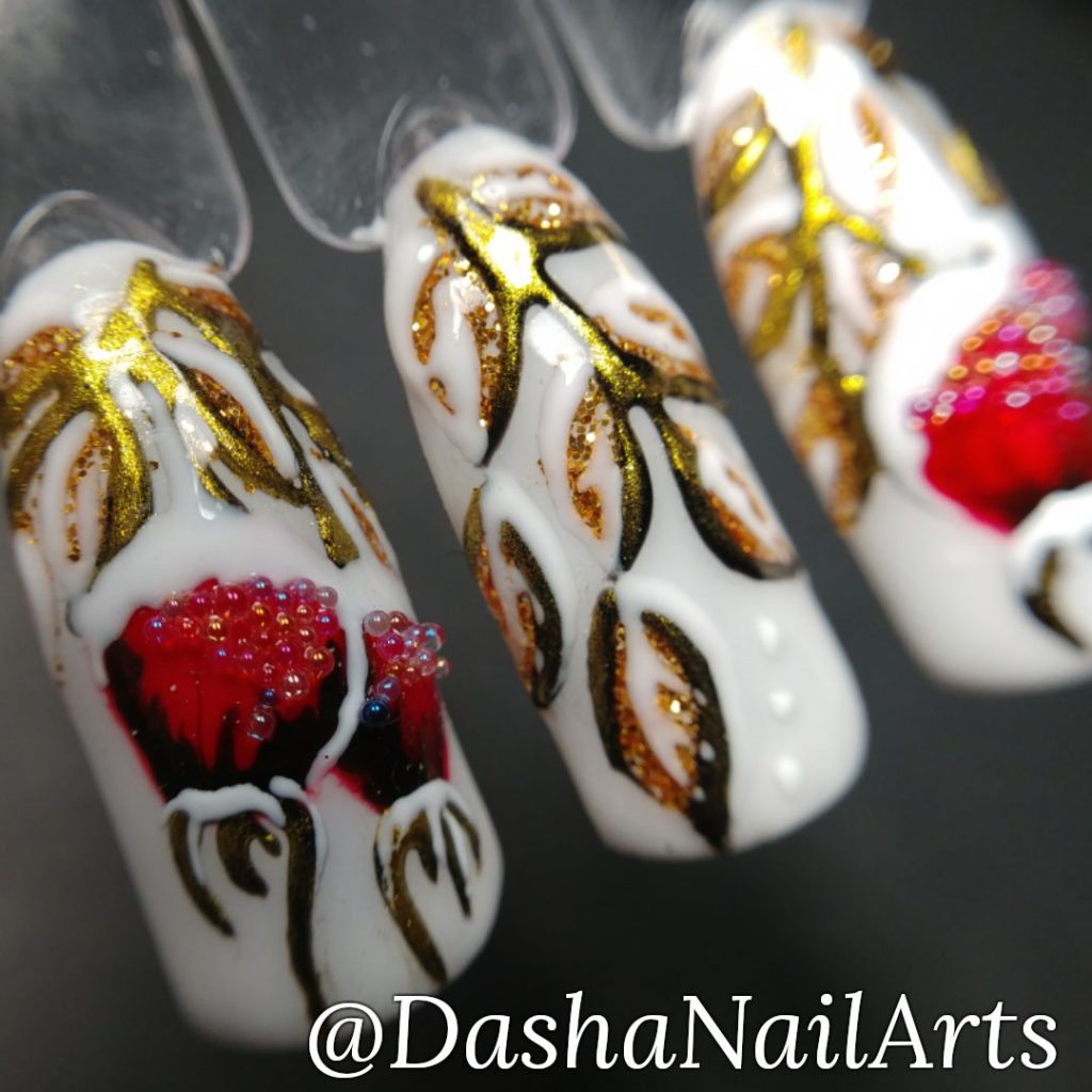 Winter nail art with red frozen berries