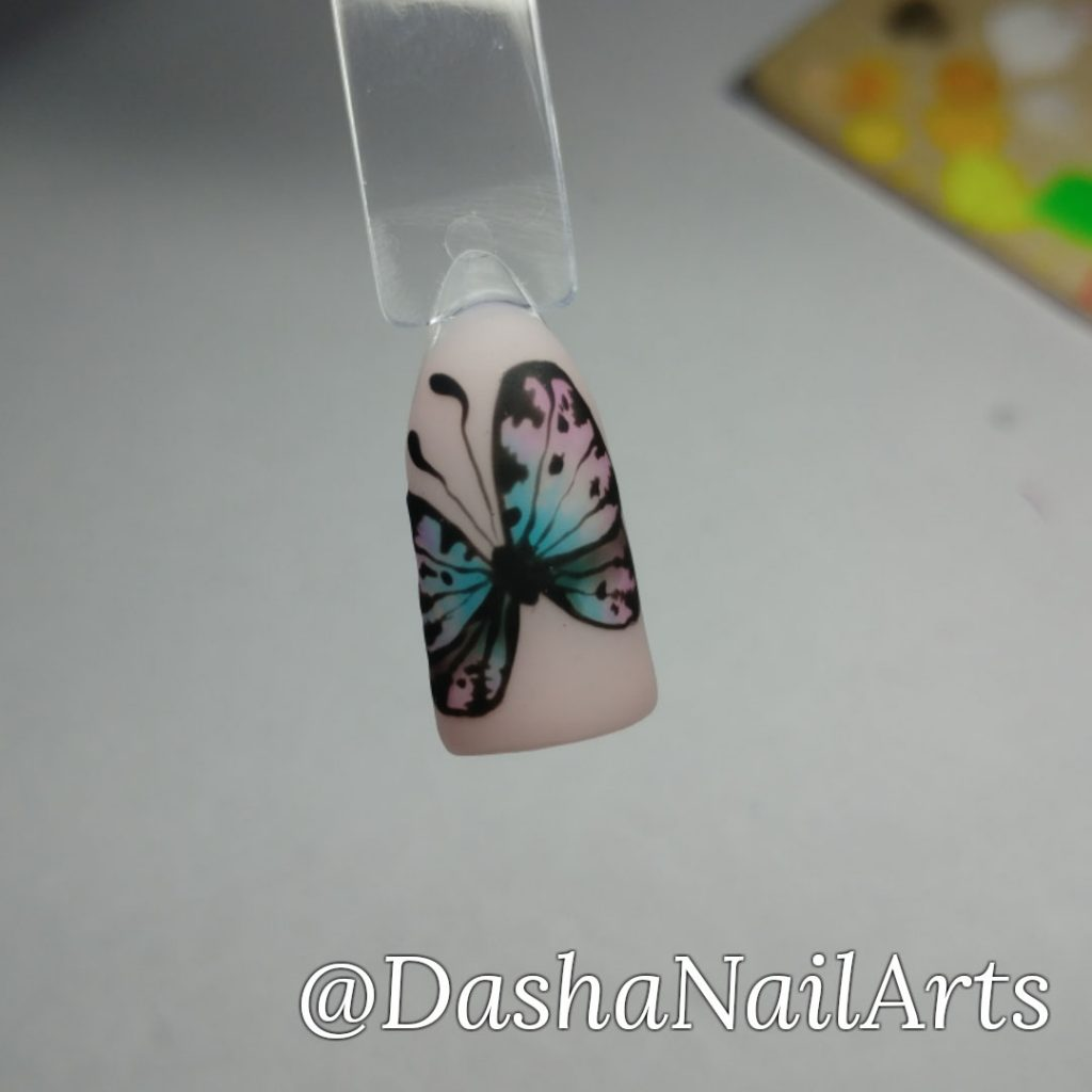 Hand drawn butterfly nail art