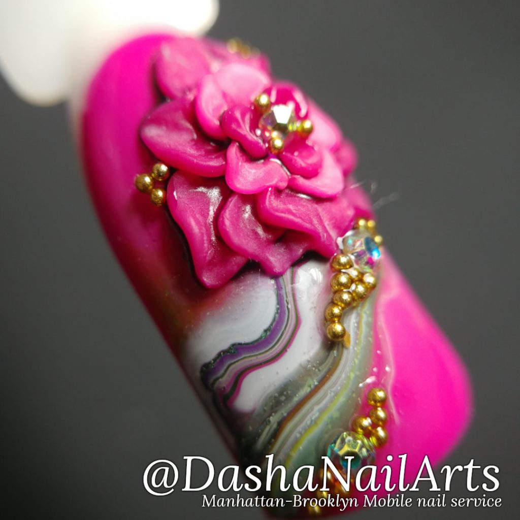 pink 3D gel flower nail design with marble pattern
