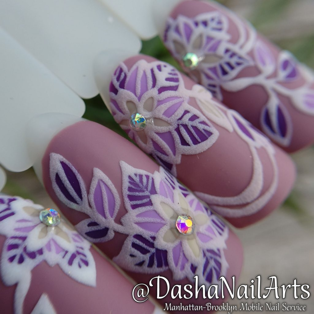 3D nails with flower pattern and diamonds