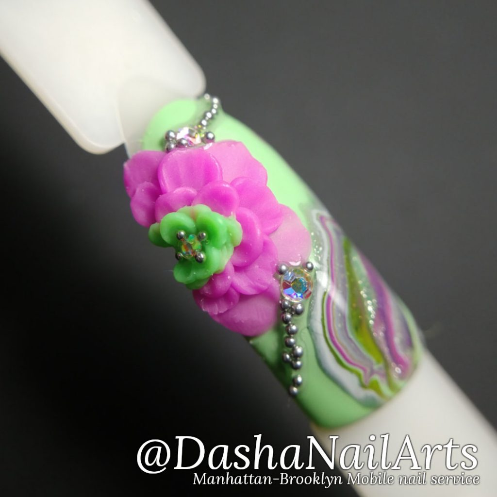 pink and green 3D gel flower nail design with marble pattern
