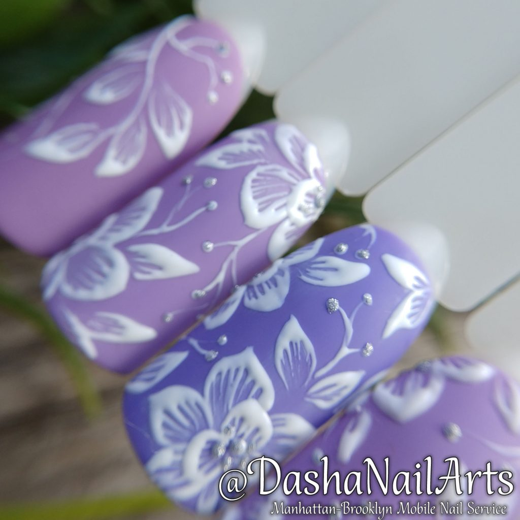 Violet 3D nails with flower patterns